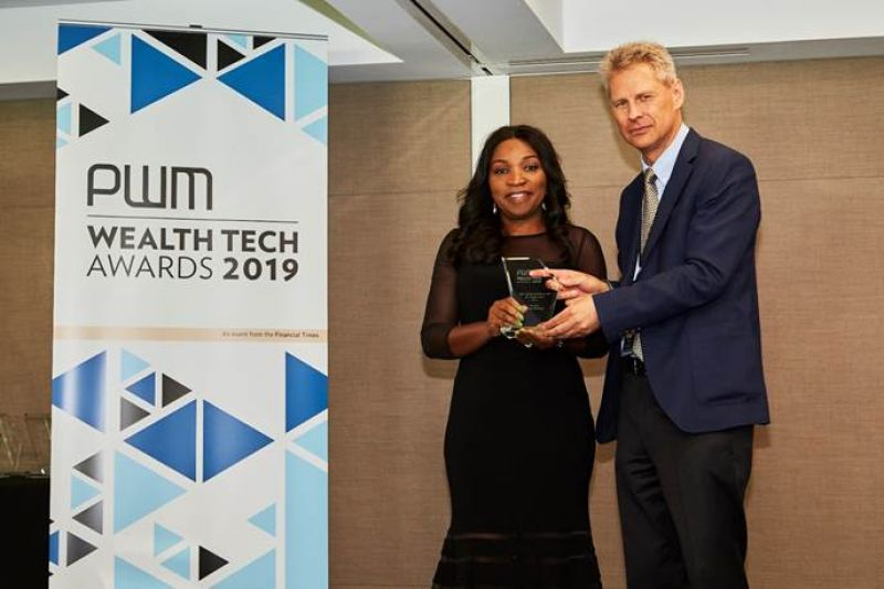 Editor-in-Chief, Professional Wealth Management at Financial Times, Yuri Bender, presenting the Wealth Tech Award to Divisional Head, Fidelity Private Banking, Chioma Nwankwo in London where Fidelity Bank emerged the 'Best Digital Networking Bank For Entrepreneurs, Africa 2019' recently.