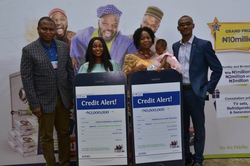 L-R Divisional Head, Retail Banking, Fidelity Bank Plc., Richard Madiebo; Winner of N2 million and  a student of Federal University of Agriculture, Abeokuta (FUAAB), Azeez Morenike Adedoyin; Winner of N1 million, Mmereole Salome Obiageri with her baby and  Regional Bank Head, Festac, Fidelity Bank Plc. Paschal Nzeribe, at the 4th Monthly /2nd Bi-nonthly Prize Presentation of Fidelity Get Alert In Millions Promo Reloaded in Ojo, Lagos recently.