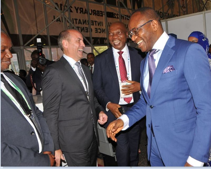 L-R: General Manager, Government Relations of Shell Petroleum Development Company, Bashir Bello; Shell's Vice President, Nigeria and Gabon, Peter Costello; and Country Chair, Shell Companies in Nigeria and Managing Director, The Shell Petroleum Development Company, Osagie Okunbor, receiving the Minister of State for Petroleum Resources, Dr. Ibe Kachikwu at the Shell exhibition stand on Monday at the opening session of the 2018 Nigeria International Petroleum Summit in Abuja.