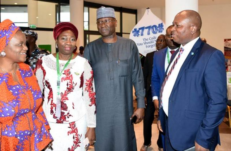 L-R: Permanent Secretary, Federal Ministry of Environment, Dr Ibukun Odusote; Chairman, Nigerians in Diaspora Commission, Mrs Abike Dabiri-Erewa; Secretary to the Government of the Federation, Mr Boss Mustapha; and Division Head, Retail Banking, Fidelity Bank PLC, Mr Richard Madiebo, at the National Diaspora Day 2019 celebration co-sponsored by Fidelity Bank PLC in Abuja - Thursday, July 25, 2019.