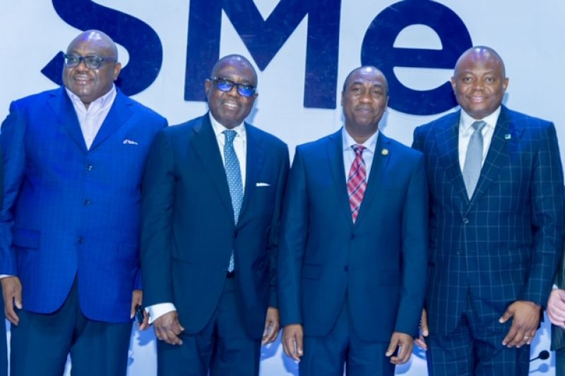 Deputy Governor of Lagos State, Dr. Obafemi Hamzat (center); flanked by Chairman, Board of Directors, Fidelity Bank  Plc, Ernest Ebi (right); Managing Director, Chief Executive Officer, Fidelity Bank  Plc, Nnamdi Okonkwo (left) ; Executive Director, Shared Services & Products, Fidelity Bank Plc, Chijioke Ugochukwu (5th left) ; Founder/ Chief Executive Officer , Beloxxi Industries Ltd, Obi Ezeude (4th left) and small business owners during the Fidelity SME funding event organized by the Bank in Lagos . . . Wednesday, Aug. 7, 2019.