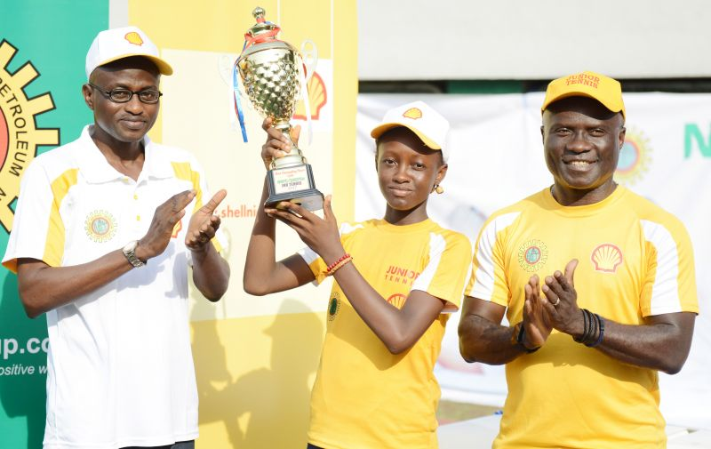 Lagos Liaison Officer, Federal Ministry of Youths and Sports, Dr. Segun Olaitan; Most Outstanding Female Player, 13-year old Rebecca Ekpeyong in the U-14 category; and the Human Resources Director, Shell Nigeria Exploration and Production Company, Mr. Obinna Anaba, during the presentation of trophy to Ekpeyong at the finals of the 2017 edition of the NNPC/SNEPCo Junior Open Tennis Championships held at the Lagos Lawn Tennis Club… on Saturday, March 11, 2017.