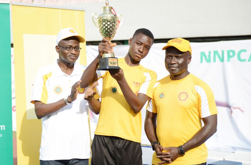 Lagos Liaison Officer, Federal Ministry of Youths and Sports, Dr. Segun Olaitan; Most Outstanding Male Player, 16-year old Phillip Abayomi in the U-18 category; and the Human Resources Director, Shell Nigeria Exploration and Production Company, Mr. Obinna Anaba, during the presentation of trophy to Abayomi at the finals of the 2017 edition of the NNPC/SNEPCo Junior Open Tennis Championships held at the Lagos Lawn Tennis Club… on Saturday, March 11, 2017.