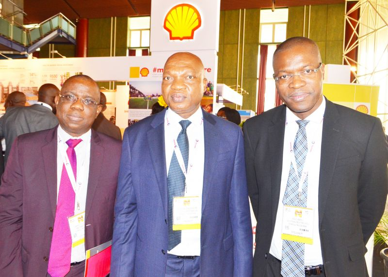 L-R: Managing Director, Shell Petroleum Development Company and Country Chair Shell Companies in Nigeria, Osagie Okunbor, welcoming Secretary General, Organisation of Petroleum Exporting Countries, Muhammad Barkindo; and the Minister of State, Ibe Kachikwu, to the Shell stand at the ongoing 16th edition of the  Nigeria Oil and Gas Conference and Exhibition in Abuja... on Tuesday.