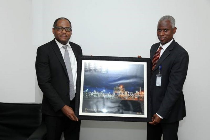 Managing Director, Shell Nigeria Gas, Ed Ubong (left) making a presentation to the Managing Director, Nigerian Gas Marketing Company, Mr. Ahmed Muhammed Abdulkabir, during a visit to Abdulkabir in Abuja... recently.