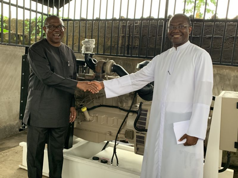 Rector of  Pope John Paul II Major Seminary Awka, Rev.  Fr.  Dr. Cyril Udebunu (right), receiving the 150 KVA Generator donated to the school by the Vice Presidential Candidate of PDP, Mr. Peter Obi, early November 2019 at the seminary premises
