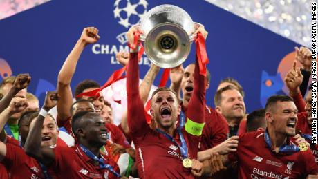•Liverpool players celebrating with the UEFA Champions League trophy on Saturday in Madrid