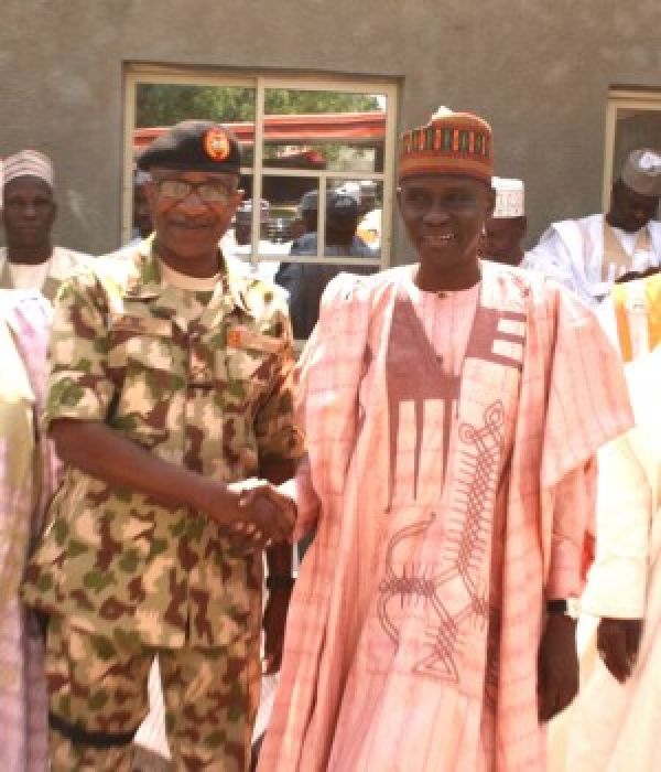 •Visiting lawmaker, Hon. Mohammed Tahir Monguno, in a group with Major General Ali Nani and others