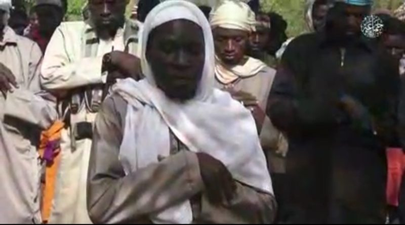 •A Boko Haram militant leads other terrorists in prayer