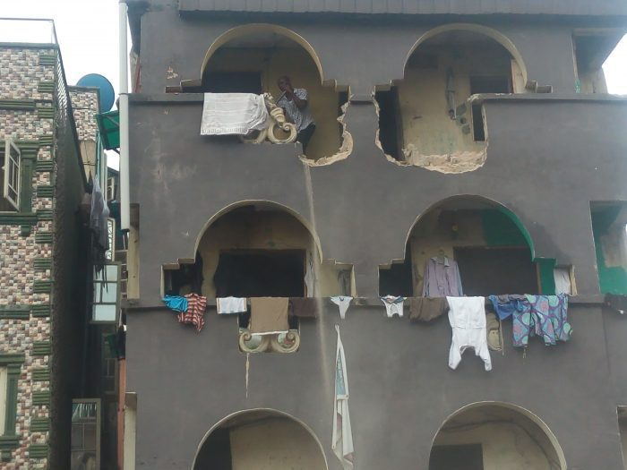 •A three-storey building being demolished on  Lagos Island
