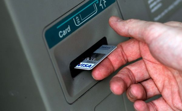 Bank customers groan as cash dries up in ATMs