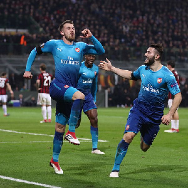 •Arsenal's Aaron Ramsey celebrating his goal . . . Thursday night against hosts AC Milan