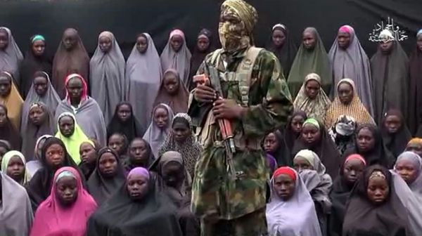•Some of the abducted Chibok girls with Boko Haram leader Abubakar Shekau.