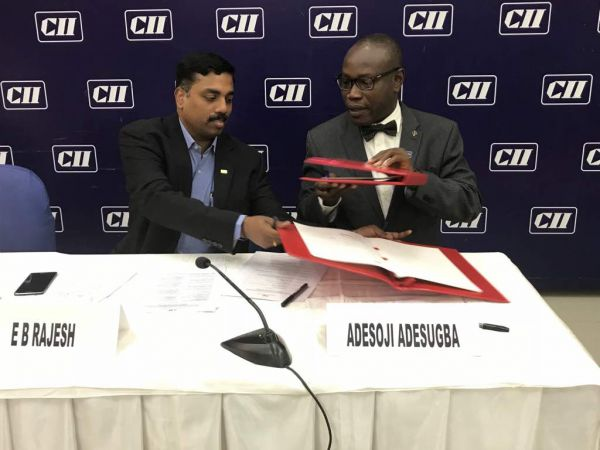 •Abuja Chamber and Confederation of Indian Industry chiefs signing the MOU