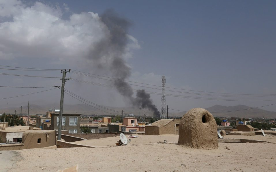 At least 100 security forces killed in fight for Afghan city