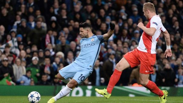 •Aguero in action against Monaco . . . Tuesday night in England.