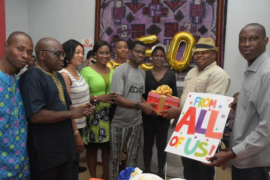 •The celebrant, Akin Adeoya, being presented with a gift by staff and ex-staff, on Friday night