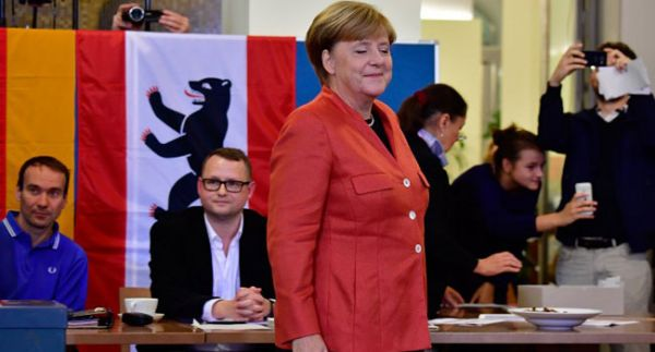 •German Chancellor Angela Merkel after casting her vote at a polling station in Berlin
