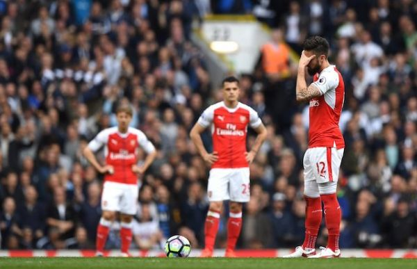 •Shocked Arsenal players after the drubbing by lowly Nottingham Forest