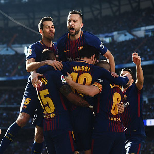 •Barcelona players celebrating . . . Saturday at the Santiago Bernabeu