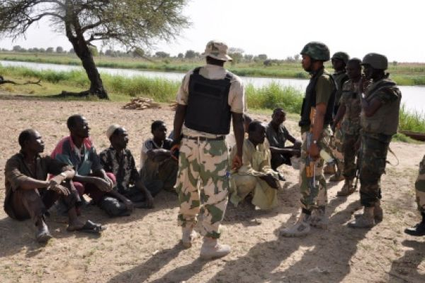 •Soldiers interrogating Boko Haram suspects.