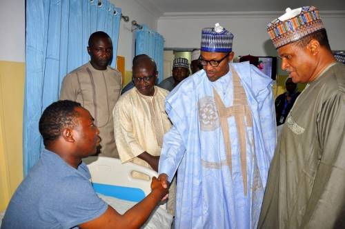 •President Buhari checks on one of the survivors