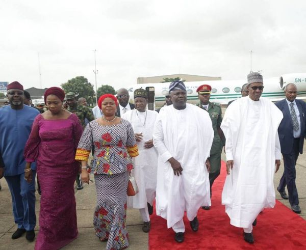 •President Buhari (R) with Governor Ambode and other top government officials, earlier Thursday in