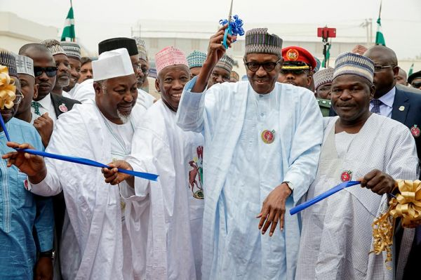 •President Buhari cutting the tape to commission a project in 2017