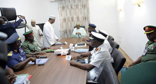 •President Buhari with security chiefs
