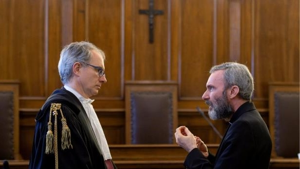 •R-L: Father Capella and his lawyer