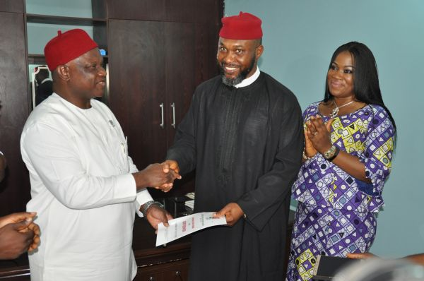 •Osita Chidoka receiving the Anambra governorship nomination form from UPP National Chairman, Chek