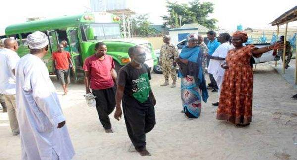 •Some of the cleared Boko Haram suspects walking away after their release.