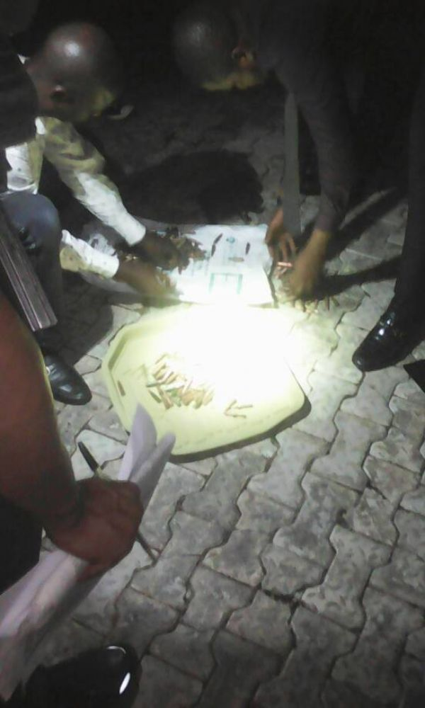 •DSS operatives counting the recovered ammunition.