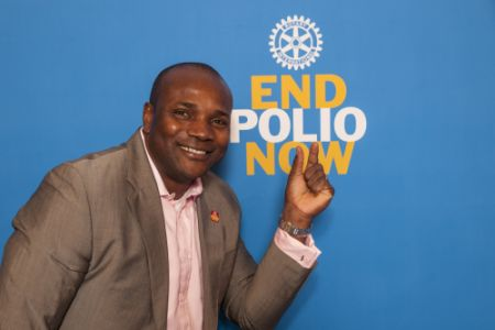 Nigerian-American Paralympic star Dennis Ogbe makes strong case for polio vaccinations during World Polio Day forum hosted by Rotary and Northwestern University