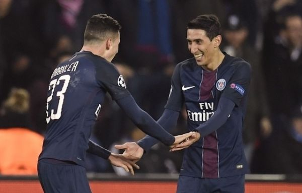 •Angel Di Maria rejoices with team mate after scoring a brace against Barcelona.