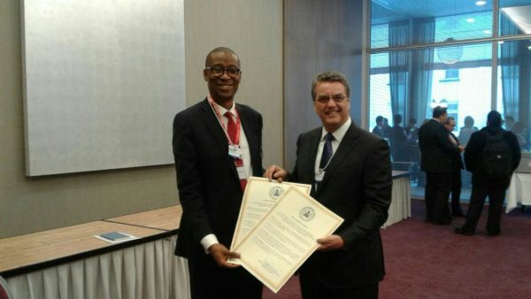 •Photo shows Enelamah handing over the instrument of acceptance of TFA to World Trade Organisatio