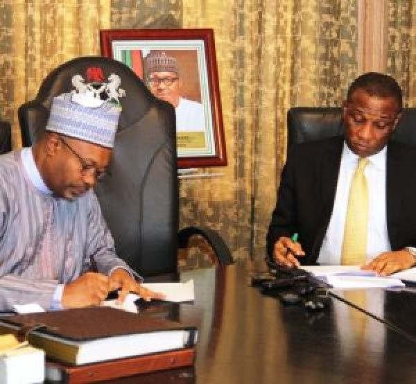 •Perm Sec, State House, Abuja, Jalal Arabi, and Lagos SSG Tunji Bello signing the MoU, on Thursday