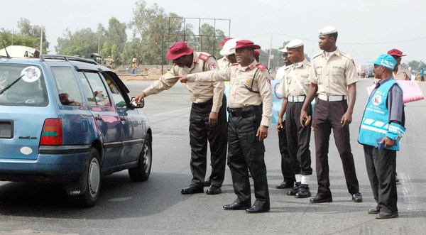 •FRSC officials conducting a routine check on a vehicle