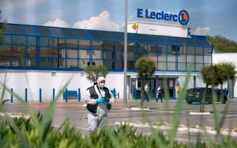 •Forensic police walk in the grounds of a supermarket where the attack took place.