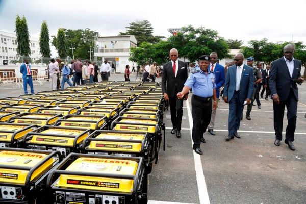 •Lagos Police Commissioner Imohimi Edgal inspecting the gensets . . . on Monday in Ikeja.