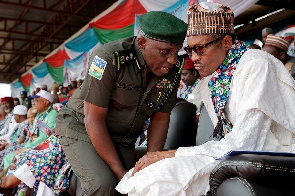 •President Buhari chatting with IGP Ibrahim Idris during a recent public function