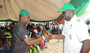 •Hon. Ihedioha (left) and his running mate Irona exchanging pleasantries