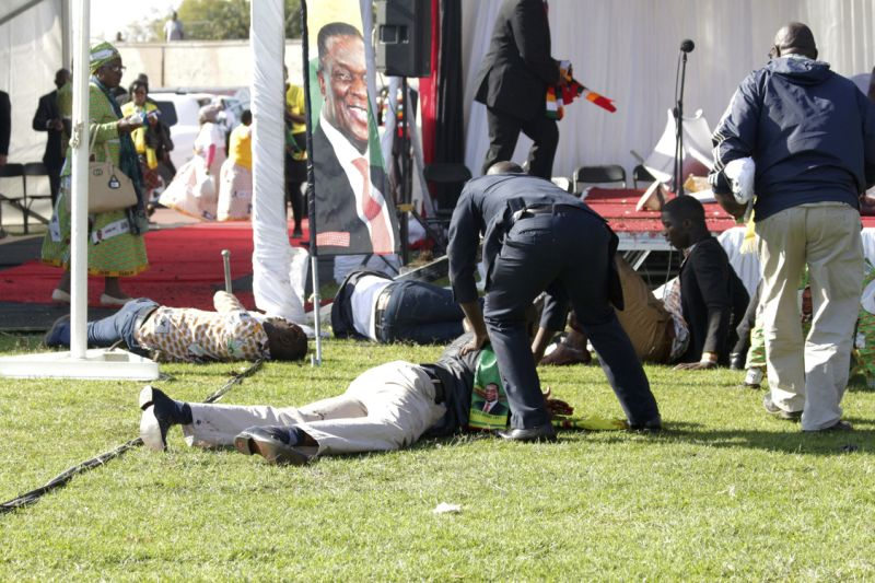 •Injured people lay on the ground following an explosion at a Zanu