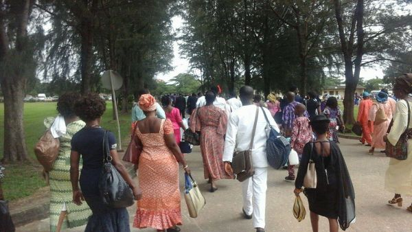 •Delegates departing the Assembly Hall of Jehovah's Witnesses, Ota, after a convention.