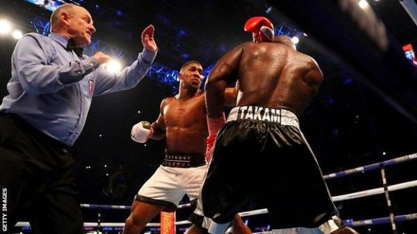 Joshua knocks out Takam to retain world heavyweight boxing titles