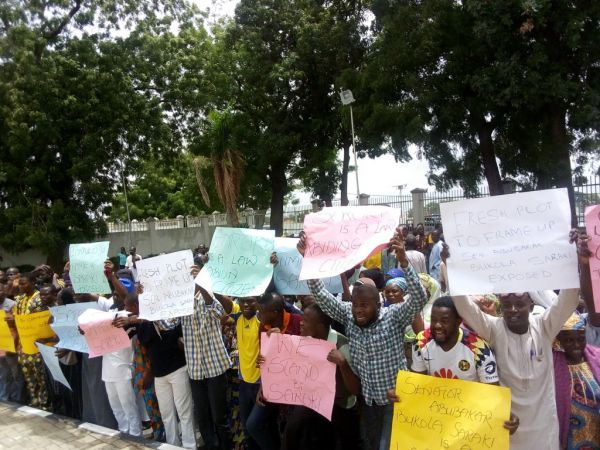 •Kwara youth displaying placards in a protest