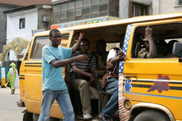 Lagos bus conductor on duty.