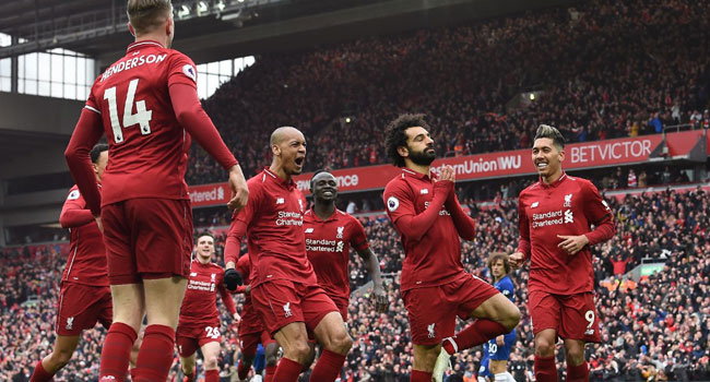 •Liverpool players celebrating Salah's goal. Photo