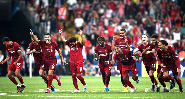 •Liverpool players celebrating