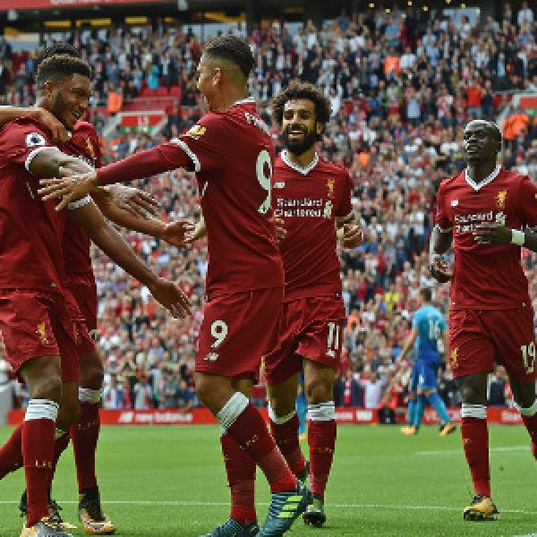•Liverpool players celebrate